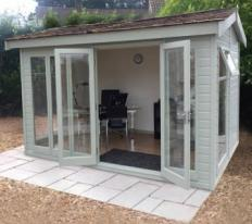 12' wide x 8' deep deal Studio Pavilion with optional cedar shingle roof, coloured external finish, painted MDF lining and laminate floor.