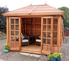 10' wide x 8' deep cedar Tudor with optional cedar slatted roof, brass upgrade, Georgian windows and doors